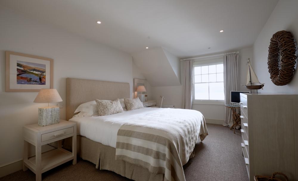 bedroom with beige bedding