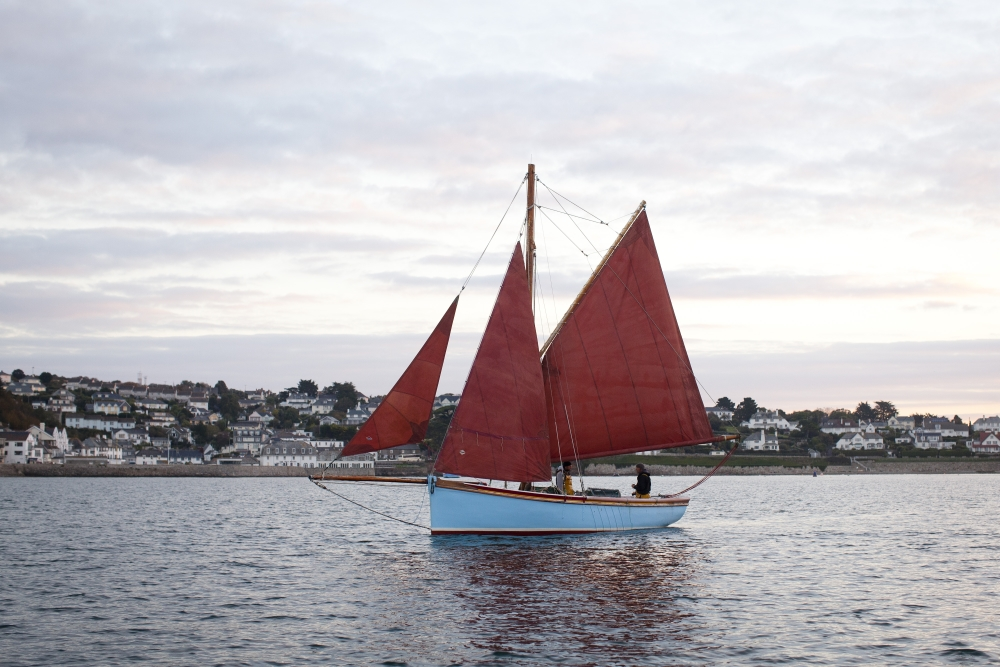 old boat with red sails at st mawes