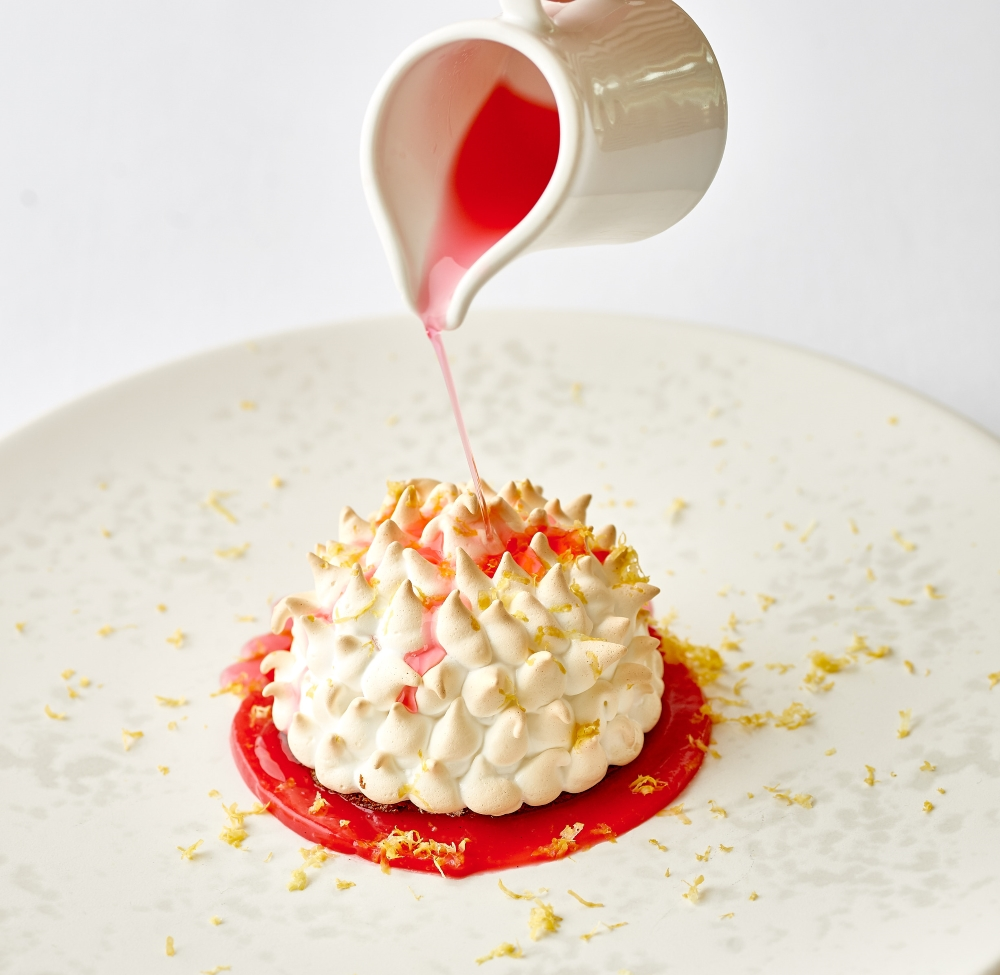 baked alaska with pouring sauce