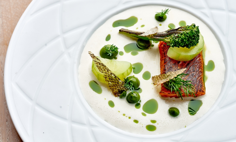 poached sea trout on white plate