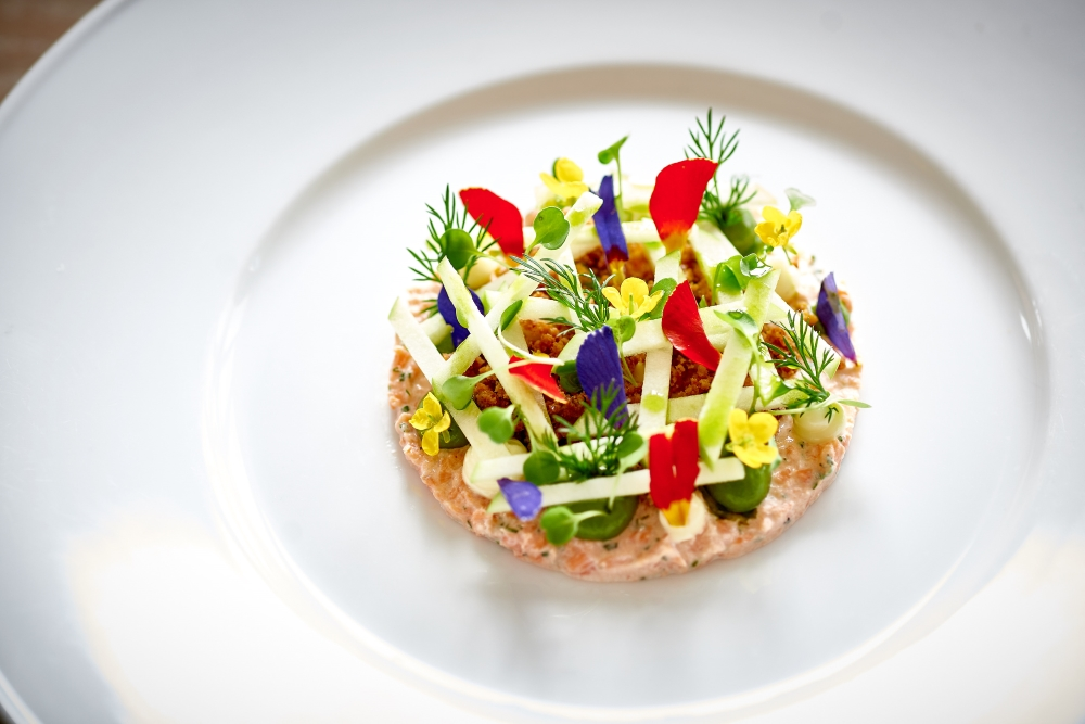 White plate with sea trout dish